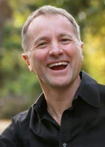 Headshot of Mark Collard, founder & director of playmeo.com