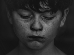 Battling bullying boy in tears. Credit kat-j-525336-unsplash