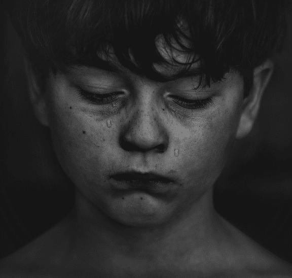 Battling bullying boy in tears. Credit kat-j-525336-unsplash
