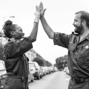 Look for the helpers, man and woman doing high-five. Credit rawpixel
