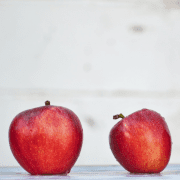 Two red apples prepared for back to school get-to-know-you games. Credit Fischer Twins