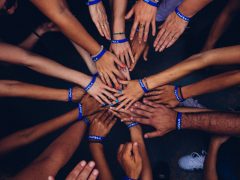 Circle of hands showing power of learning together. Credit Perry Grone