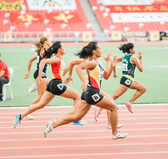 Women running on track demonstrating physical activity. Credit Jonathan Chng