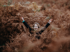 Project Wild Thing - Kid standing in tall bracken. Photo credit: Annie Spratt