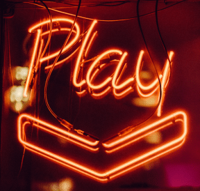 Neon sign displaying definition of play. Photo credit: Clem Onojeghuo