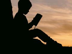 Little boy telling stories. Photo credit: Aaron Burden