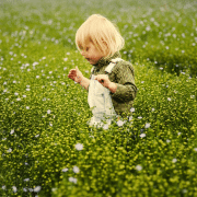Girl in meadow, enjoying notion of get kids to play outdoors