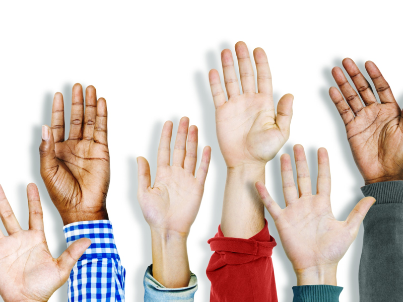 Hands raised in air as part of Have You Ever variation