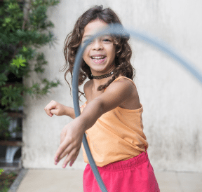 Girl swinging hula-hoop, as ideal summer professional development for teachers. Photo credit: Patricia Prudente