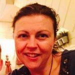 Headshot of Simone Garrett, who is having fun as a playmeo subscriber