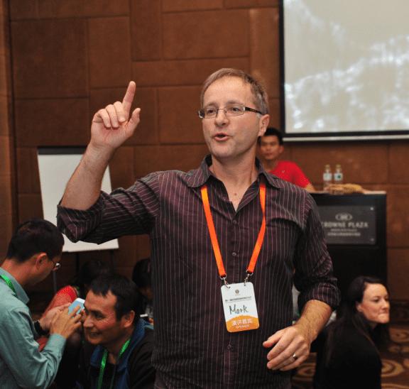 Mark Collard presenting a facilitator training workshop in China