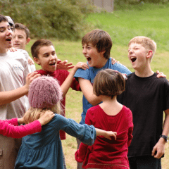 Benefits of play reflected in image of group of children playing: Photo credit: Jennifer Benoit