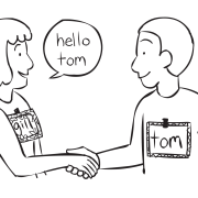 Two people shaking hands in a fun get-to-know-you Name-Tag game