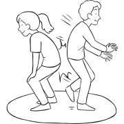 Two people standing back to back in a circle, trying to bump each other out, as seen in Butt Wars energiser game