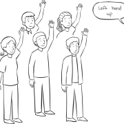 Group of people with left arms in the air, playing Simon Says Stretch