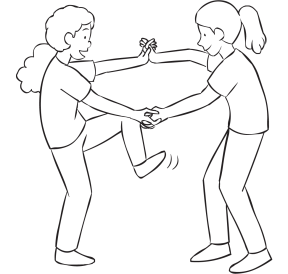 Two women holding hands and attempting to step inside their arms as part of fun energiser Wring Out Stretch