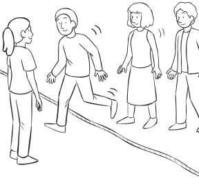 Group of people walking across a rope on the ground, as part of About Now group initiative