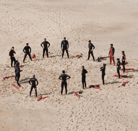 Bring people closer together like these surf life savers. Photo credit: Margarida Csilva