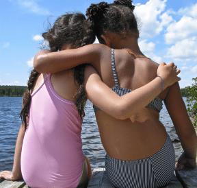 Two girls practising their friendship skills