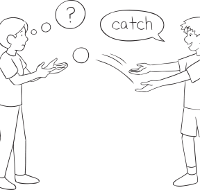 Two pleople passing a ball as part of Push Catch group game