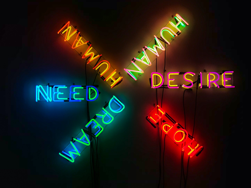 Neon sign with four emotional needs. Credit Stephan Valentin