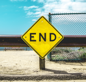 Road sign pointing to end long-term programs. Credit: Matt Botsford