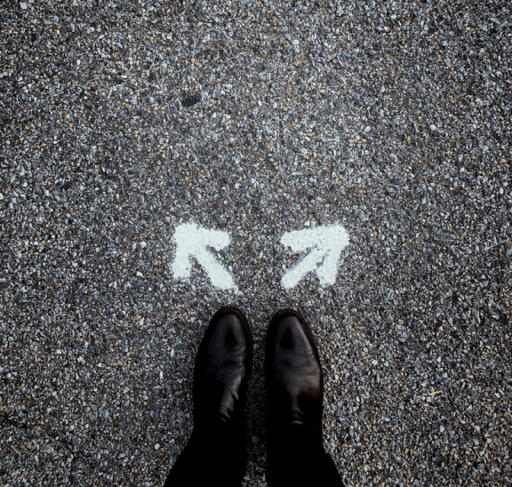 Looking down at shoes with two arrows, how to pick the right activity. Credit: Jon Tyson