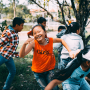 Girl running in group, showing key elements of play. Credit Mi Pham