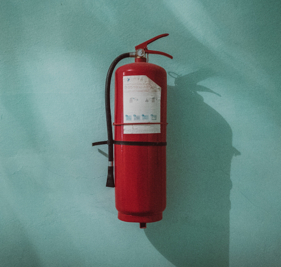 Fire extinguisher on wall keeping people safe