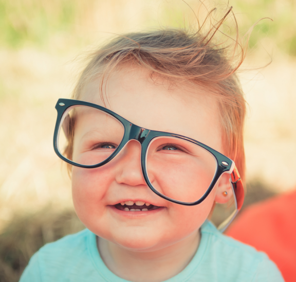 Baby with glasses sharing four leadership lessons. Credit Andriyko Podilnyk