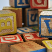 Wooden toy blocks offering inclusive language