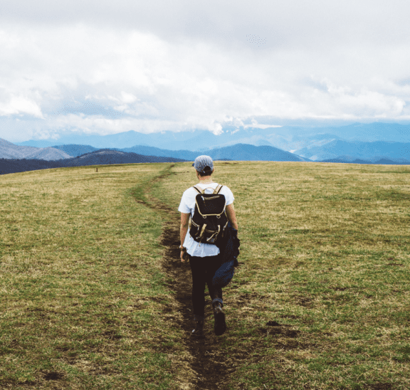 Man walking on journey considering a debriefing tip. Credit Joshua Ness